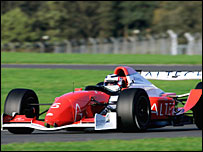 Niegel Mansell takes the car through its paces at Silverstone