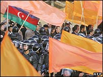 Azerbaijani police watch protesters