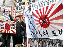 South Korean activists hold anti-Japanese placards during a protest against the new Japanese textbooks, in front of the Japanese embassy in Seoul, 06 April 2005.
