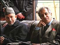 Afghan President Hamid Karzai (left) and Zalmay Khalilzad