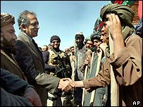 Zalmay Khalilzad (second left) shakes hands with Afghan construction workers