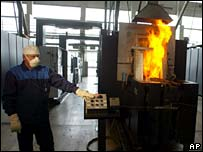 Worker operates machine producing uranium tablets in Kazakh city of Oskemen