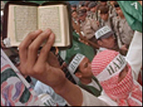 Protesters carrying the Koran