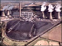 Power station showing coal heap and cooling towers.  Image: BBC