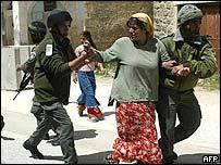 Settler being arrested in Hebron