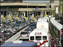 Cars wait to cross into the US from Mexico