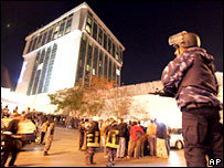 A Jordanian policeman stands guard by the Radisson hotel