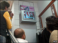 Lebanese watch Assad speech in a clothes shop