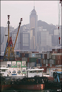 Chinese exports being loaded onto ships at Hong Kong