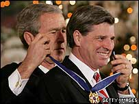 Paul Bremer, right, receives the US's highest civil honour, the Presidential Medal of Freedom, from President George Bush in December 2004