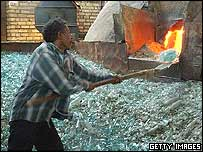 Iraqi worker in a glass factory