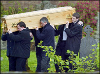 Mr Wilson's coffin is carried into the church