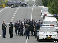 Police man a road block near a police shooting in outer Sydney Tuesday, 8 November 2005.