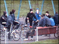 Youths congregate in a park