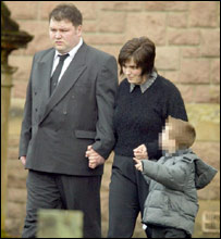 Veronica Wilson, and her son Andrew, four, outside the church