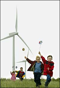 Wind turbine with children playing. Image: PA