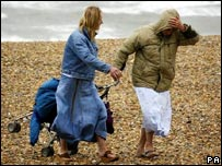 Holidaymakers coping with bad weather on an East Sussex beach