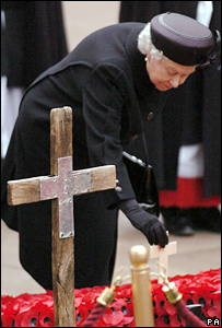 The Queen lays a remembrance cross