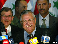 Jalal Talabani speaks to reporters after being chosen as interim president by Iraq's parliament