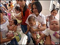 Mothers and their babies at a free immunisation clinic in the Philippines