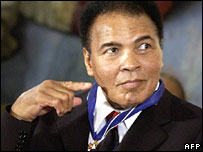 Muhammad Ali gestures to President Bush at the White House medal ceremony
