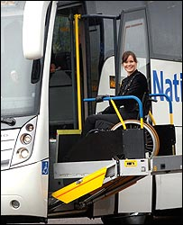 Photo of a wheelchair using woman using the coach's lift