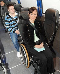 Photo of a wheelchair user sitting inside a coach