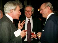 Lichfield joking with the Duke of Edinburgh as Barry Norman looks on
