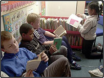 Children reading books in school