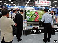 Shoppers in a Tokyo electronics store
