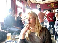 Woman smoking in a pub