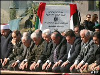 Senior Palestinians pray by tomb of Yasser Arafat, where the foundation stone has been laid for a museum