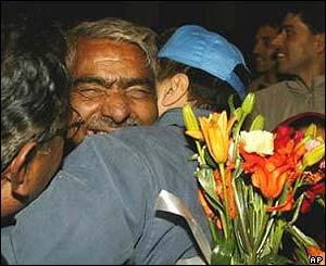 Joy in Srinagar as a passenger from Muzaffarabad is greeted by a relative.