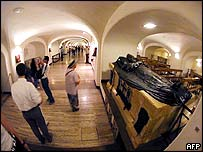 Tourists and pilgrims visiting tombs in the Vatican crypt