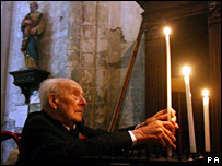 Henry Allingham lighting a candle