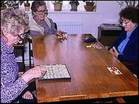 Elderly women playing bingo