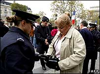 Police check bags of people during armistice day commemorations