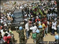 Supporters surround the convoy of Liberian presidential contender George Weah in Monrovia