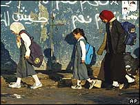 Children walk to school in the Sadr City district of Baghdad