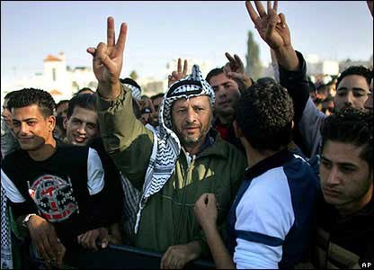 A man dressed as Yasser Arafat