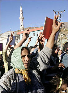 Kurdish women make the V-for-Victory sign at funeral in Semdinli