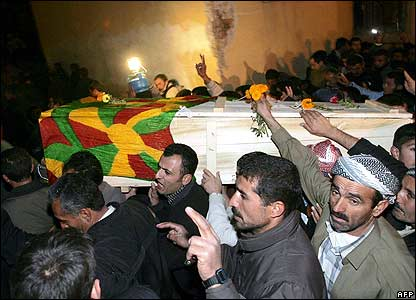 Mourners carry coffin draped in Kurdish flag through Semdinli