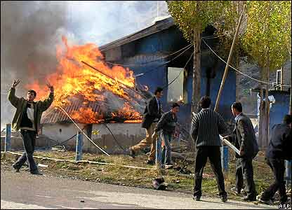 Rioters burn a police checkpoint in Semdinli