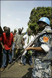 UN soldier watches Weah supporters in Monrovia