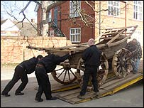 A wagon being unloaded at the museum