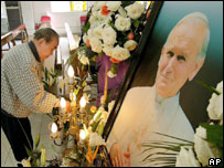 In a rare relaxation of rules, a man prepares a symbolic funeral bier for a service dedicated to the late Pope John Paul II in Shanghai,  April 8, 2005.