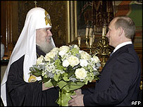 President Vladimir Putin (right) congratulates Patriarch Alexy II on his birthday