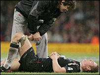 A stricken Brent Cockbain is attended to by Wales medical staff