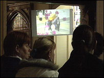 People watch the funeral in a Belfast church