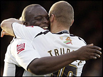 Swansea goal-scorers Adebayo Akinfenwa and Lee Trundle celebrate